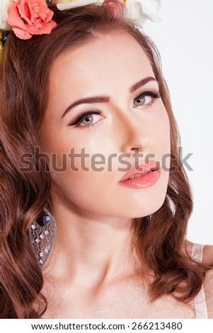 Beautiful sensual woman wearing floral wreath - stock photo