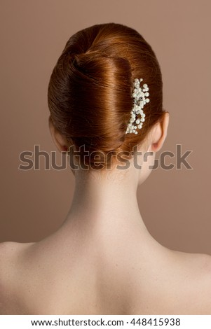 Beautiful sensual woman with elegant hairstyle.Beauty wedding hairstyle. Bride. Wedding accessories. Red hair. - stock photo