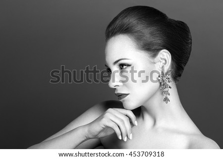 Beautiful sensual woman with elegant hairstyle.Beauty wedding hairstyle. Bride. Wedding accessories. Black and white photo. - stock photo