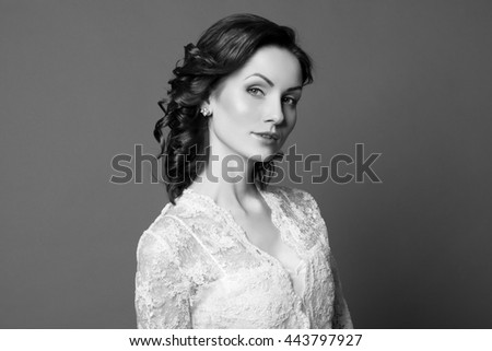 Beautiful sensual woman with elegant hairstyle. Woman with perfect skin, red hair. Wedding fashion