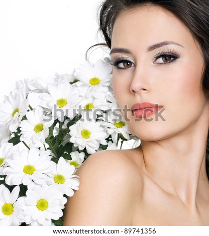 Beautiful sensual woman with  flowers - white background
