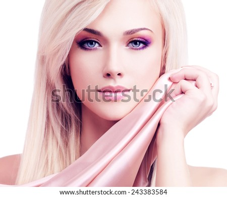 Beautiful sensual woman with pink silk posing at studio isolated on white. - stock photo