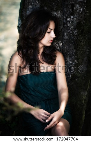 Beautiful sensual young woman in the wood near the river - stock photo