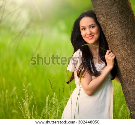 Beautiful sensuality elegance brunette woman, has happy fun cheerful smiling face, white linen dress. Has slim body, clear skin. Portrait great nature. Sunny sunset forest - stock photo