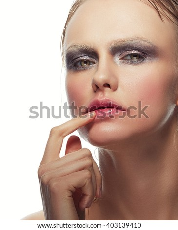 Beautiful sensuality elegance caucasian lady face woman, green eyes, blonde hair, sexy lips, finger near kissed effect lips. Studio portrait. Vogue style makeup. Isolated on white background. Toned - stock photo