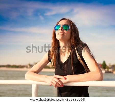 beautiful sensuality elegance haired hair woman happy fun cheerful smiling blue sunglasses black t-shirt urban city portrait nature slim sport body space impressions - stock photo