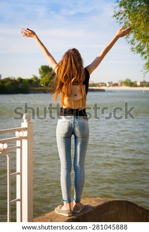 beautiful sensuality elegance lady haired woman happy fun back black t-shirt jeans urban city portrait nature slim sport body river blue sky river water ass - stock photo