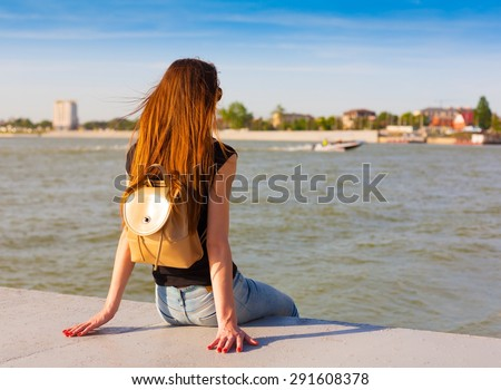 beautiful sensuality elegance lady red haired hair woman happy fun back black t-shirt jeans urban city portrait nature slim sport body river blue sky river water - stock photo