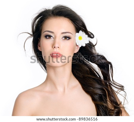 Beautiful sensuality glamour woman with clean skin and flowers in her long hair - white background