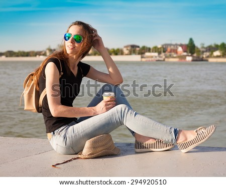 beautiful sensuality haired hair woman happy fun cheerful look smiling blue sunglasses black t-shirt jeans river urban city portrait nature slim body space impressions bright rest - stock photo