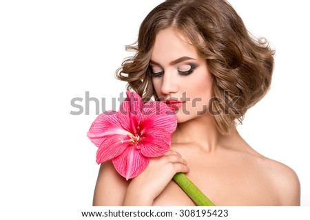 Beautiful sensuality woman with fresh skin of face and flower - white background