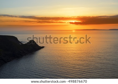beautiful serene sunset over loop head with the ballybunion coast on the wild atlantic way in ireland