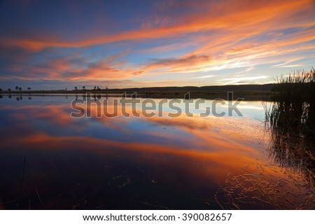 Beautiful serene sunset over Penrith Lakes and Blue Mountains Australia with lake reflections of the sky above