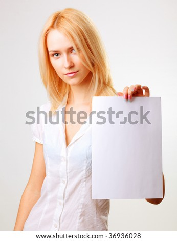 Beautiful serious blond woman showing blank paper sheet. Closeup. Isolated.