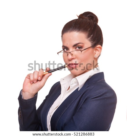 Beautiful, serious hispanic businesswoman  wearing glasses and a formal office suit, holding pen, looking at camera.