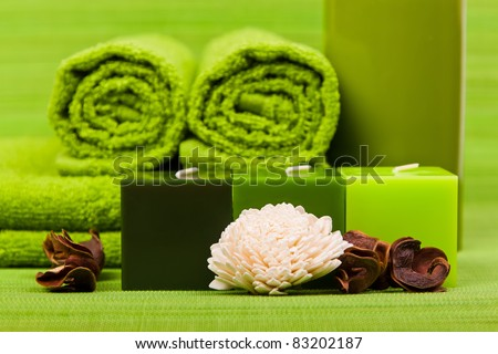 Beautiful set for spa and aromatherapy on a green background - stock photo