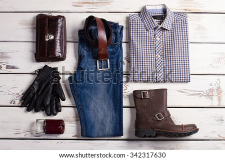 Beautiful set of men's clothing on a white wooden background. - stock photo