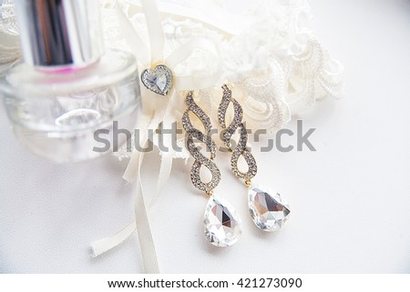 Beautiful set of wedding accessories, perfume and earrings