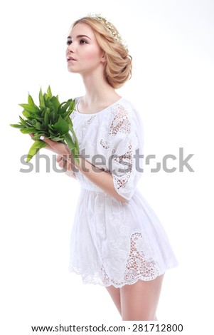 Beautiful sexual blonde  in white clothes with the basket of flowers isolated on a white background - stock photo
