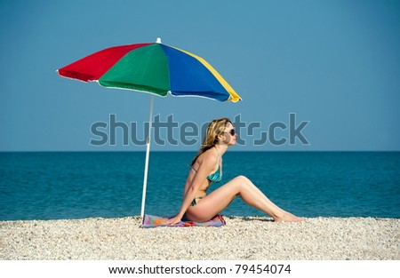 Beautiful sexual girl blonde pose on beach in swimsuit - stock photo