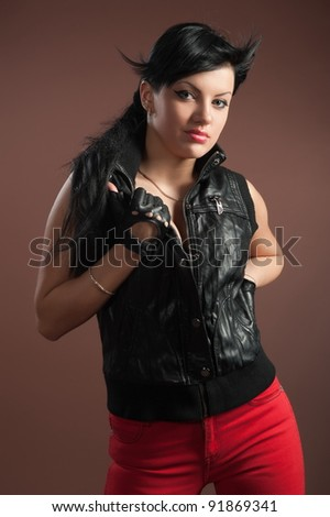 Beautiful sexual girl brunette pose on brown background - stock photo