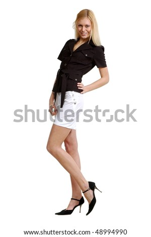 Beautiful sexual girl in shorts and coat for summer on white background is insulated