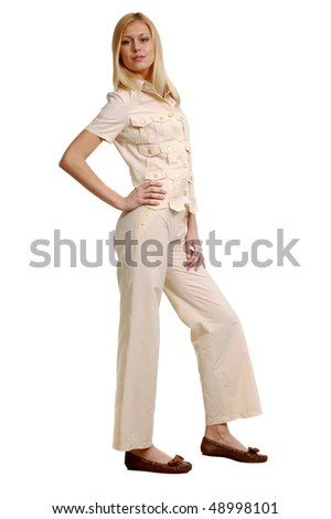 Beautiful sexual girl in trousers and coat for summer on white background is insulated