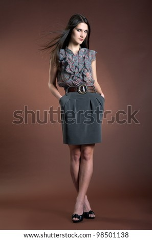 Beautiful sexual girl model pose on brown background - stock photo
