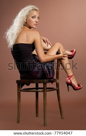beautiful sexual girl of the blonde on brown background