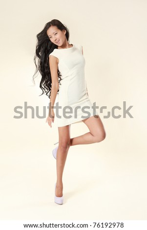 Beautiful sexy asian woman in stylish white dress.  Studio shot - stock photo