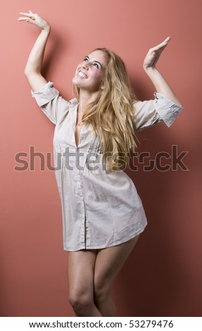beautiful sexy blond girl in the morning with a mens shirt - stock photo