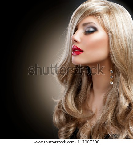 Beautiful Sexy Blond Girl. Long Hair. Blonde isolated on Black Background. Holiday Makeup.Make-up. Glamour Woman - stock photo