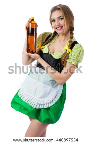 Beautiful sexy blond girl waitress Oktoberfest in Bavarian traditional dress holding a bottle of beer isolated on white background.