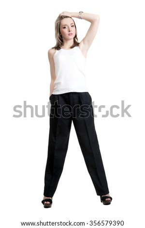 Beautiful sexy blonde girl in black pants and t-shirt - stock photo