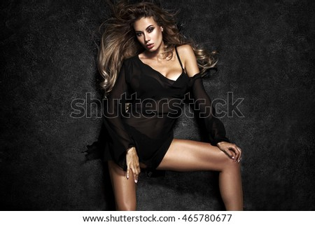 Beautiful sexy blonde woman on black background
