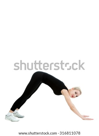 Beautiful sexy blonde woman plays sports on a white background isolated