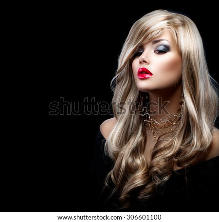 Beautiful Sexy Blonde Woman with Long Hair. Blond Girl isolated on Black Background. Holiday Makeup. Red sexy lips, Make-up. Glamour lady - stock photo