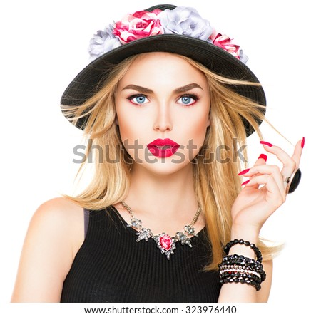 Beautiful sexy blonde woman with red lips and manicure in modern black hat. Beauty fashion model girl portrait with accessories- bracelets, necklace and elegant hat, isolated on a white background - stock photo