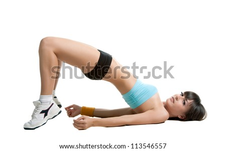 Beautiful sexy brunette girl posing in sportswear on white background