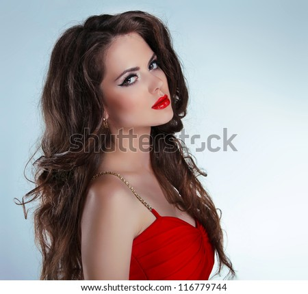 Beautiful sexy brunette girl with red lips and curly hairs in dress - stock photo