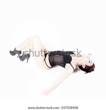 Beautiful sexy brunette with black lingerie isolated on white background with eyes closed - stock photo