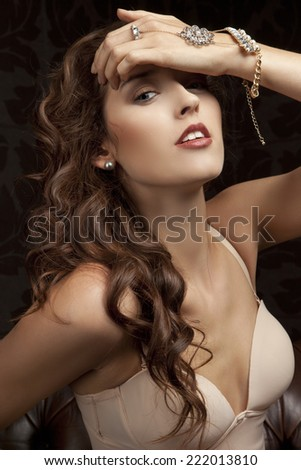 Beautiful, sexy brunette with expensive bracelet - portrait - stock photo