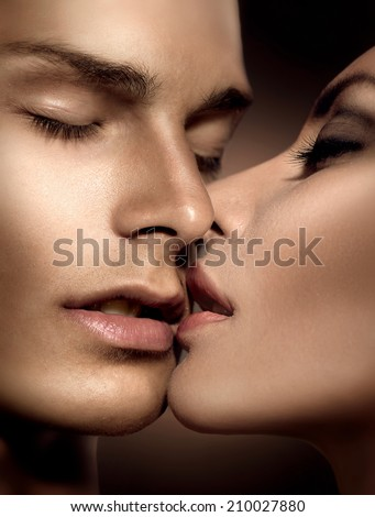 Beautiful sexy couple portrait. Model man and beauty young woman kissing. Passion - stock photo