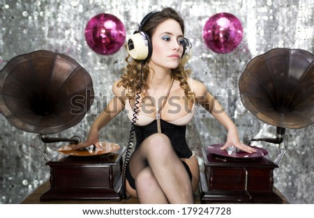 beautiful sexy disco dj with gramophones. Perfect for stylish club, disco and fashion events  - stock photo