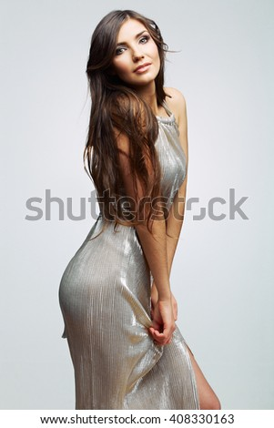 Beautiful sexy fashion  model woman posing in evening dress. Isolated.