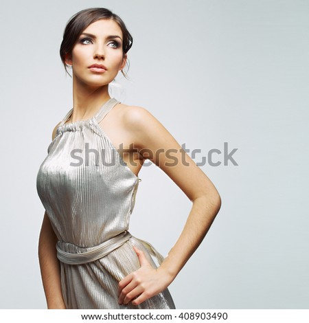 Beautiful sexy fashion  model woman posing in evening dress. Isolated. - stock photo