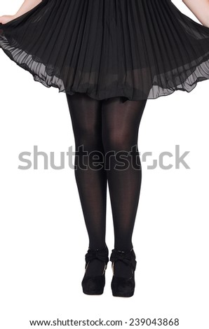 Beautiful sexy female legs in black tights with a butterfly on a white background - stock photo