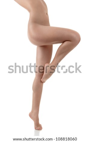 Beautiful sexy female long legs isolated on white background - stock photo