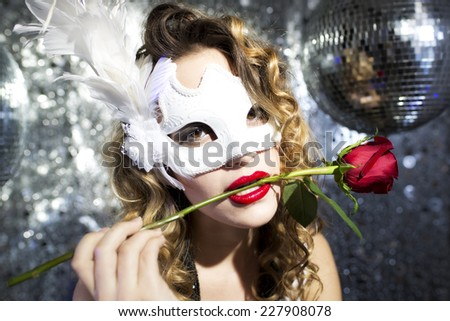 beautiful sexy female with venetian carnival mask and rose. Useful for parties, clubs and events  - stock photo