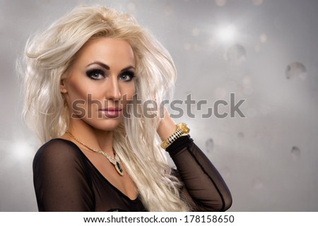 Beautiful sexy fresh young woman in party dress smiling happy looking at camera with smile - stock photo